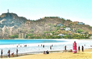 View of San Juan Del Sur's beach from Restaurante Vivian. (Mrs. Pink Stilts asks for money:)