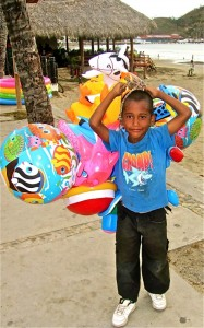 Other kids are more entrepreneurial like this lad selling floaties. Kudos to him for working hard on a hot day!